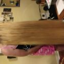 Long beautiful straight shiny blonde hair, never been damaged with heat or dye. 20 - 25 inches long.
